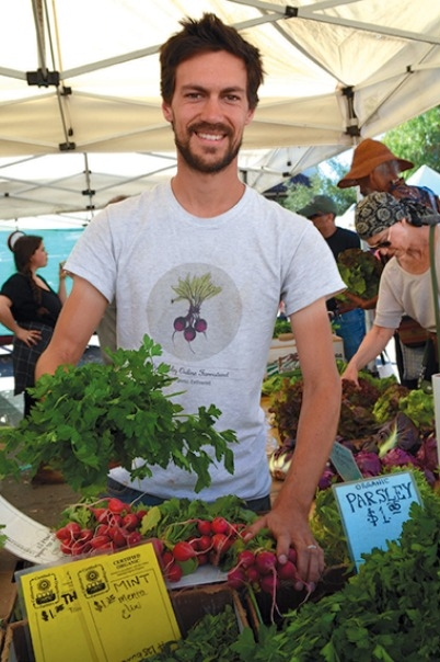 Max Becher of Ojai Valley Online Farmstand also works the Earthtrine Farm farmers' market stand.